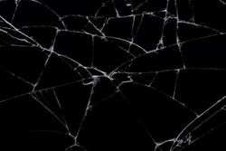 Broken black glass, with white lines on black glass.
