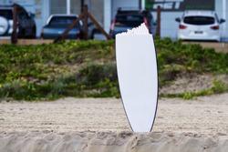 Broken board on beach.