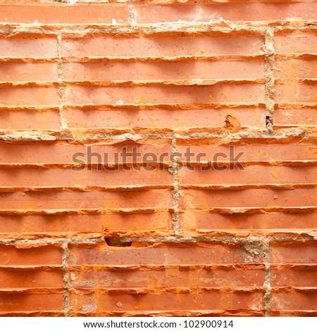 broken bricks in brickwall in wall restoration construction