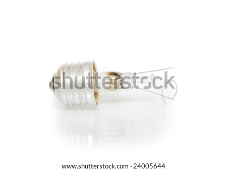 Broken bulb with mirror reflection isolated on white