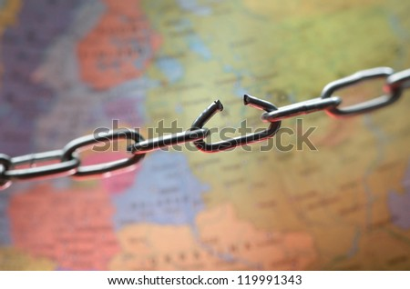 Broken chain link above the world map