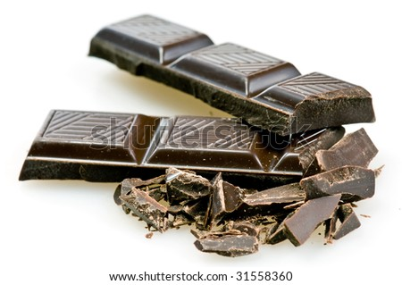 broken chocolate over white background with copy space