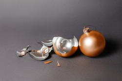 Broken christmas toy to decorate the new year holidays on a dark gray background