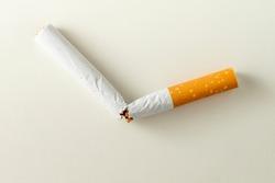 Broken cigarette on white background , World No Tobacco Day Tobacco and lung health concept .