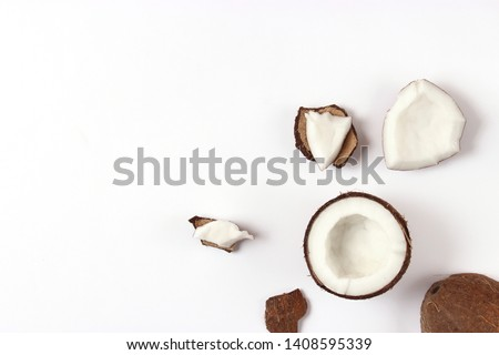 broken coconut on a white background top view.