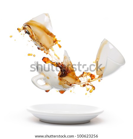 Broken coffee mug with splash of coffee. Isolated on white