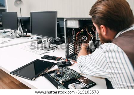 Broken computer disassembling, close-up. Repairman take apart CPU to find failure reason. Electronic repair, renovation concept Stock photo ©