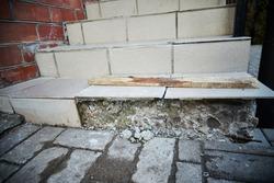 broken concrete staircase. broken entrance stairs.