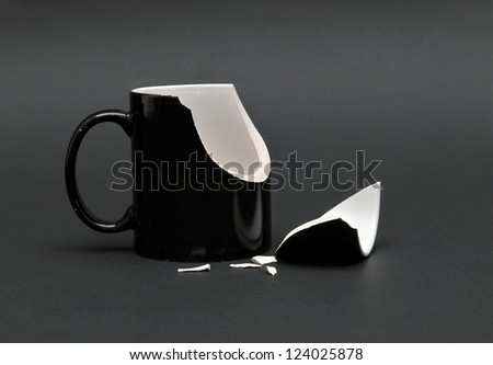 Broken Cup On Black Background Stock Photo 124025878