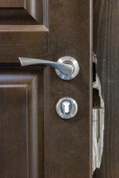 Broken dark wooden door with handle