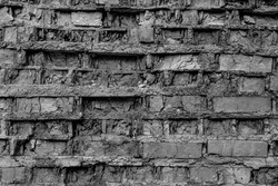 Broken decay old plaster of brick stone wall texture. Damaged black white bumpy facade, chipped ruined creepy castle background. Dirty horror dungeon, muddy crashed disaster exterior for 3d design