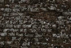 Broken decay old plaster of brick stone wall texture. Damaged erosion bumpy gloomy facade, chipped ruined creepy castle background. Dirty horror dungeon, muddy crashed mould exterior for 3d design