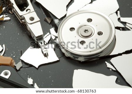 Broken - destroyed hard drive disk, macro focused on read write head