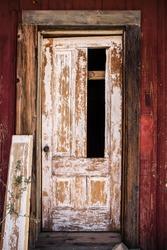 broken door on abandoned home