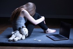 Broken down lonely teenage girl with depression sitting alone in room