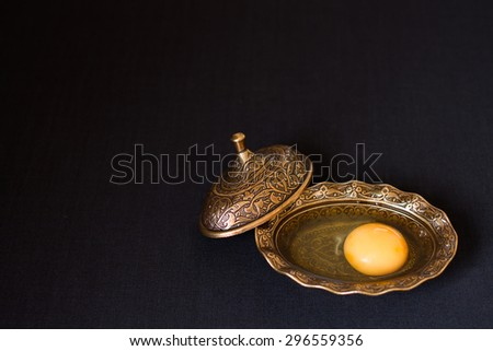 broken egg in authentic plate. yolk and white together