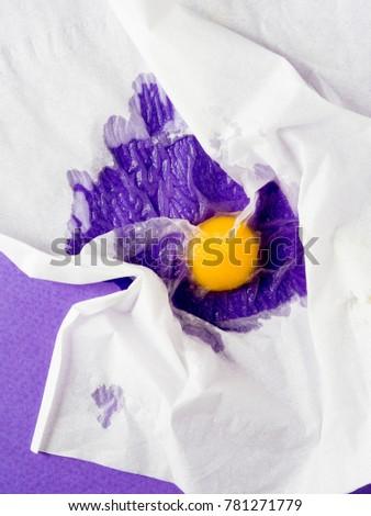 Broken egg under a napkin. Food mishap. Shot from above #781271779