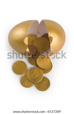 Broken egg with golden coins at white background