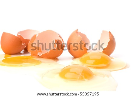 broken eggs isolated on white background close up