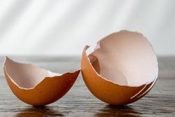 Broken eggshell on rustic wooden table