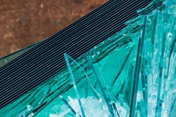 Broken flat glass panes in a recyclable container