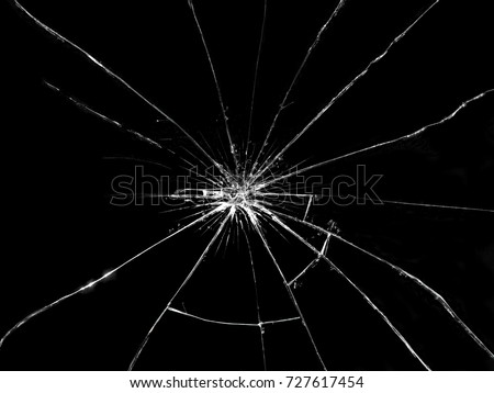 Broken glass. Abstract black background.