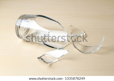 Broken glass and glass splinters close up  #1335878249
