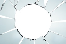 Broken glass and hole isolated on white texture wallpaper background  object design crash accident concept