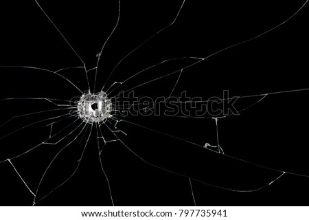 Broken glass background with bullet hole. Isolated on black background.
