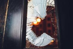 Broken glass black door of the shop.