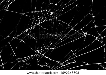 broken glass. cracks isolated on black background Stockfoto ©