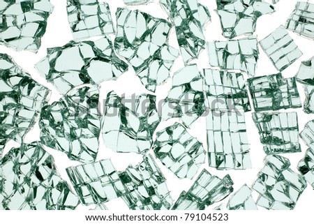 broken glass from a cars window, pieces placed on a white background