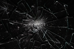 Broken glass on black  with glass splinters and cracks