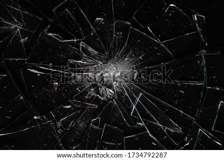 Broken glass on black  with glass splinters and cracks Stock photo ©