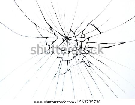 Broken glass on window isolated crack on white background. Cracks concept for design. #1563735730