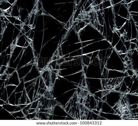 Broken glass over black background