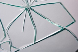 Broken glass pile pieces of texture and background isolated on white, cracked window effect. Emergency condition