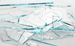 Broken glass pile pieces texture and background, isolated on white, cracked window effect