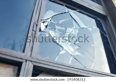 broken glass window reflecting blue sky