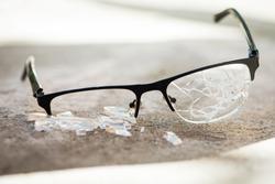 broken glasses on the asphalt. street accident concept. poor eyesight