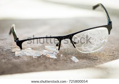 broken glasses on the asphalt. street accident concept. poor eyesight #725800054