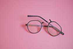 Broken glasses on the pink background