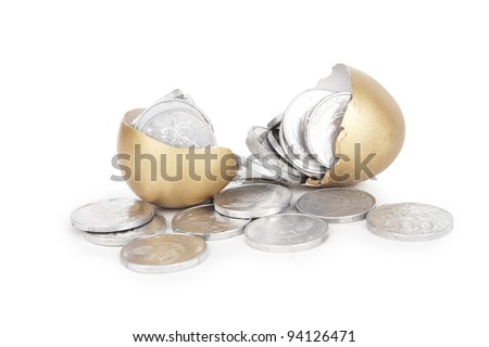 Broken golden eggs with coins on white background