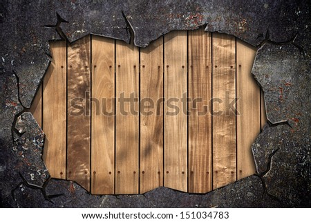 broken grunge wall with wooden wall inside