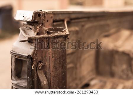 broken head light rusty truck, old color tone