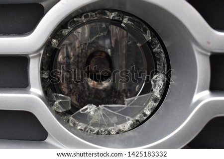 Broken headlight on a car #1425183332