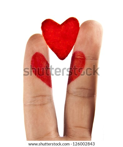 broken heart painted on two fingers of divorced