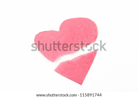 Broken heart shape made of pink paper