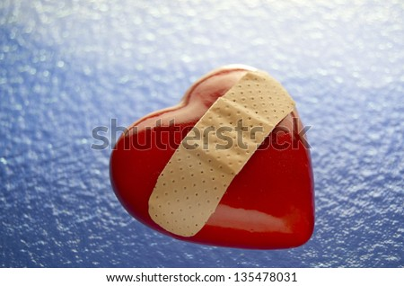 Broken Heart With Band Aid On Blue