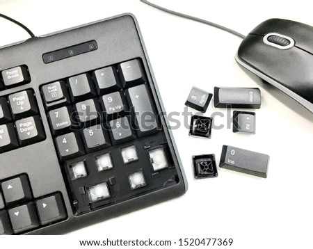 broken keyboard, the bottom fall out of keyboard' s body and near mouse isolate on white background stock photo